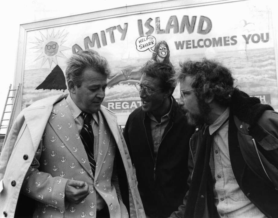 Murray Hamilton, Roy Scheider, and Richard Dreyfuss standing in front of defaced billboard in a scene from the film 'Jaws', 1975. (Photo by Universal/Getty Images) Photo: Getty Images