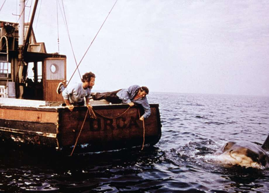 American actor Richard Dreyfuss (L) and British actor Robert Shaw (1927 - 1978) hold ropes while leaning off the back of their boat, 'Orca,' in pursuit of the giant Great White shark in a still from the film, 'Jaws,' directed by Steven Spielberg, 1975. (Photo by Universal Pictures/Fotos International/Courtesy of Getty Images) Photo: Getty Images