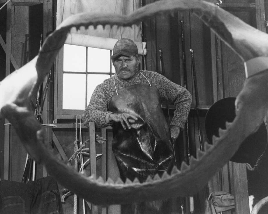 English actor Robert Shaw (1927 - 1978) as Quint, viewed through a set of shark jaws, in a publicity still for 'Jaws', directed by Steven Spielberg, 1975. (Photo by Silver Screen Collection/Getty Images) Photo: Getty Images