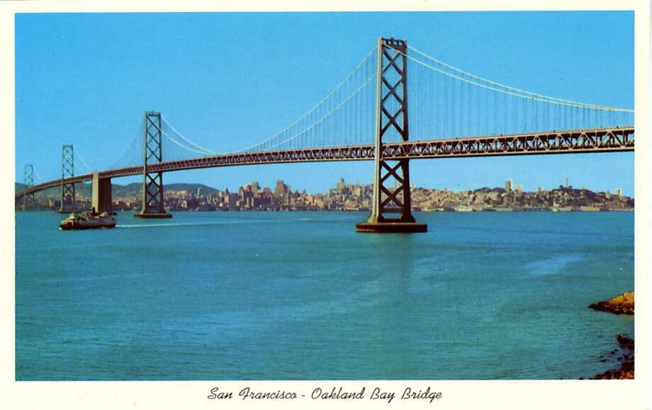 Vintage 1957 postcard showing the San Francisco-Oakland bridge spanning San Francisco Bay, the city skyline ia in the distance. Photo: Curt Teich Postcard Archives