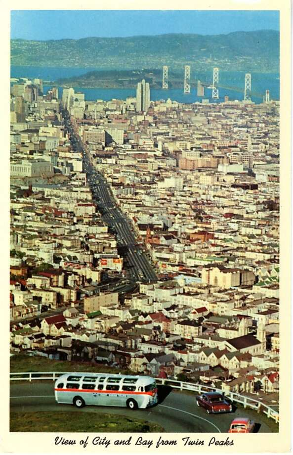 Vintage postcard showing a bird's eye view of San Francisco and the Bay. The San Francisco-Oakland Bay Bridge is visible in the distance. Photo: Curt Teich Postcard Archives