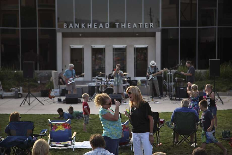 Music fans enjoy a concert by Slippery Road last month outside the Bankhead Theater in Livermore, sponsored by the Livermore Valley Performing Arts Center. Photo: Preston Gannaway, Special To The Chronicle