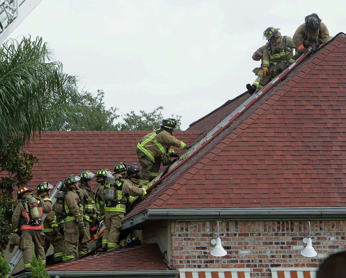 Houston Fire Department firefighters work at the scene of a 1 alarm restaurant fire at the Guadalajara Mexican Grille in the 2900 block of Southwest Freeway Tuesday, Aug. 6, 2013, in Houston.