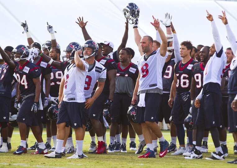 Players cheer on kicker Randy Bullock after he make a long kick at the end of practice.