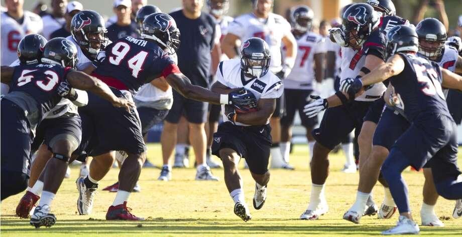 Running back Dennis Johnson, center, runs the ball. Photo: Brett Coomer, Chronicle