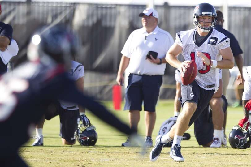 Quarterback T.J. Yates scrambles in the pocket.