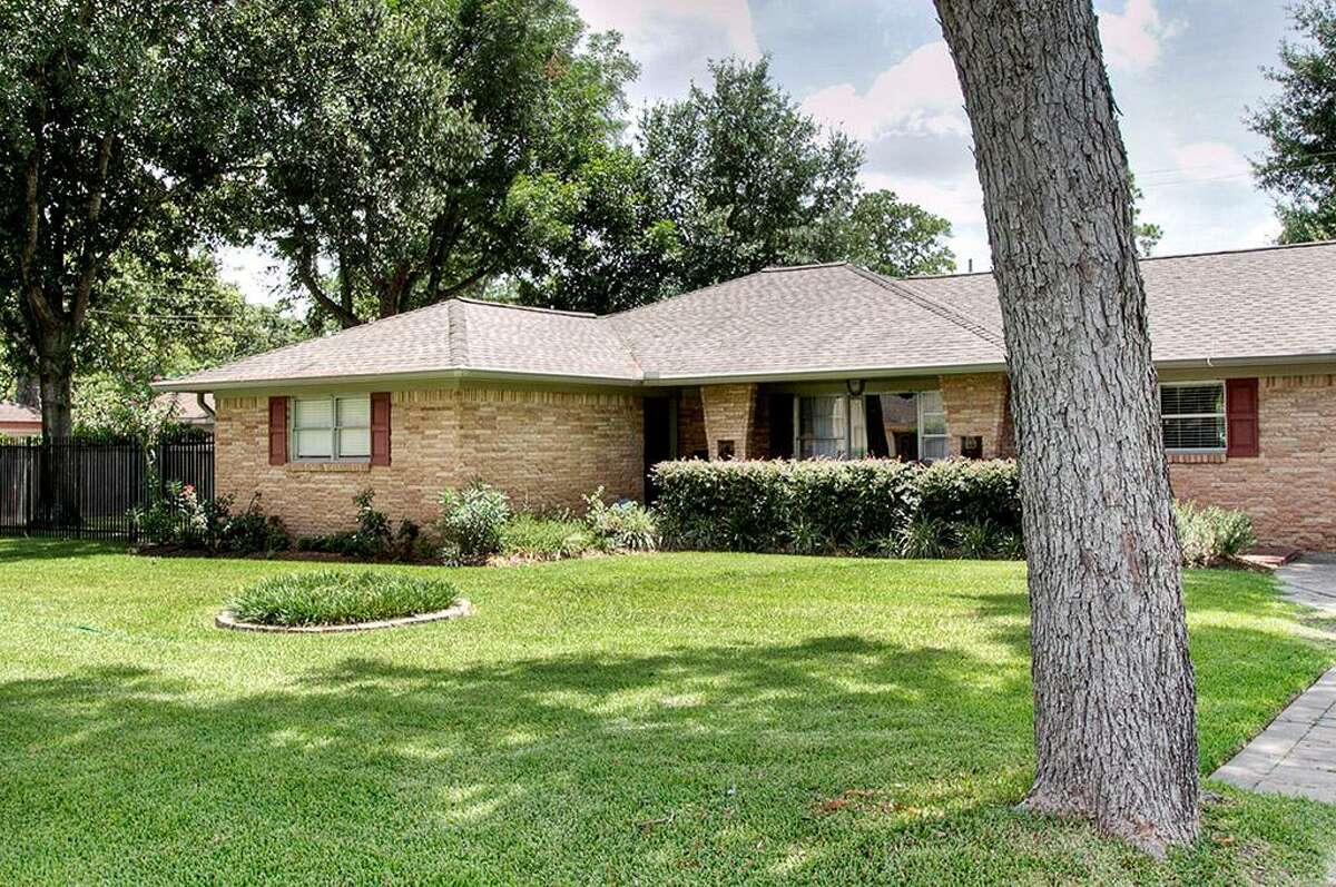 This traditional ranch home offers three bedrooms and four baths.