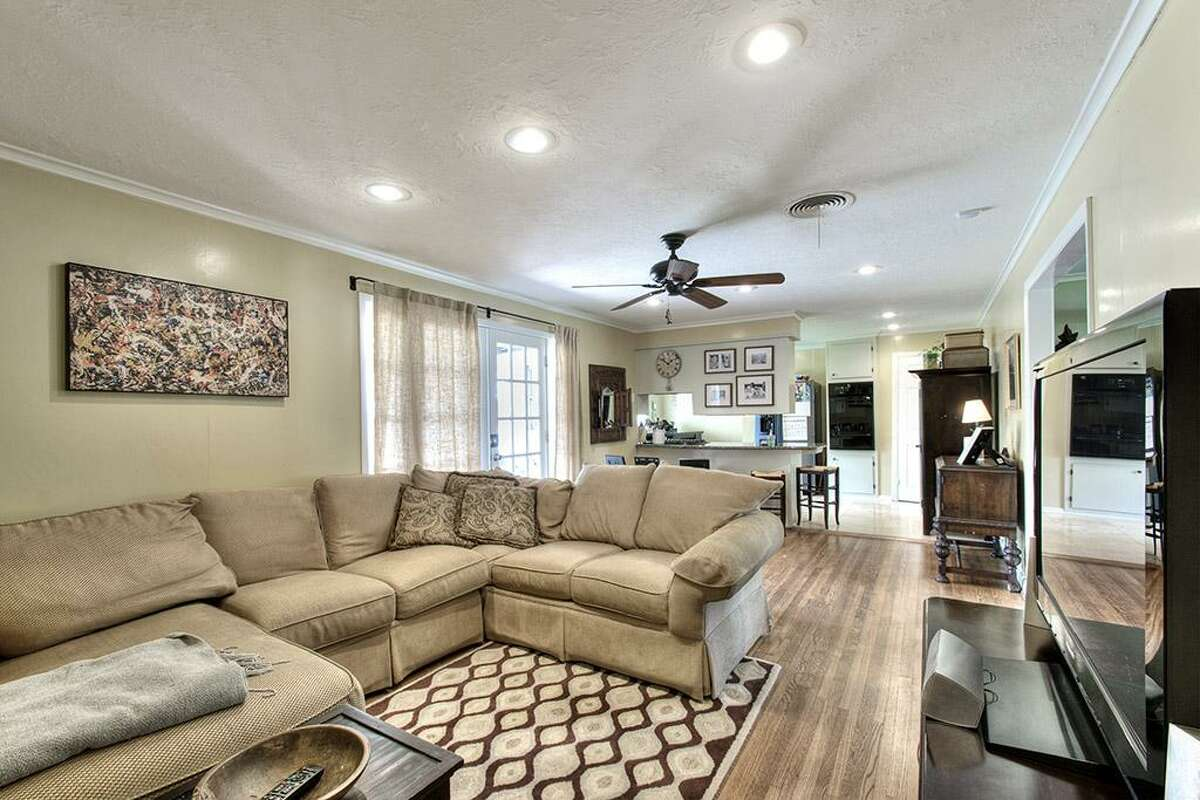 The living room features a set of French doors, hardwood floors and recessed lighting.