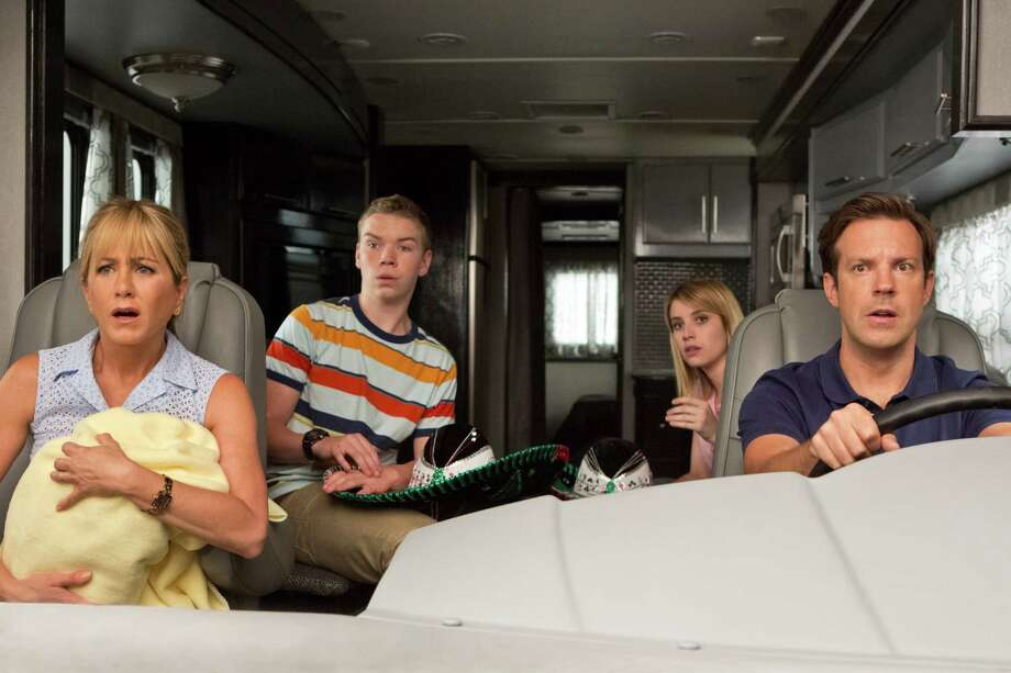 "This film image released by Warner Bros. Entertainment shows, from left, Jennifer Aniston, Will Poulter, Emma Roberts, and Jason Sudeikis in a scene from ""We're the Millers."" (AP Photo/Warner Bros. Entertainment, Michael Tackett) ORG XMIT: NYET845 Photo: Michael Tackett / Warner Bros. Entertainment"
