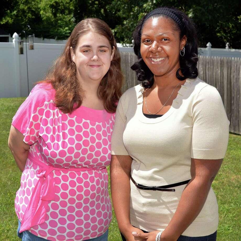 Megan Cataldo, left, and childhood friend Lakeshia Motley of Clifton Park in the backyard of Megan's Albany, NY, home Thursday July 25, 2013.  (John Carl D'Annibale / Times Union) Photo: John Carl D'Annibale / 00023295A