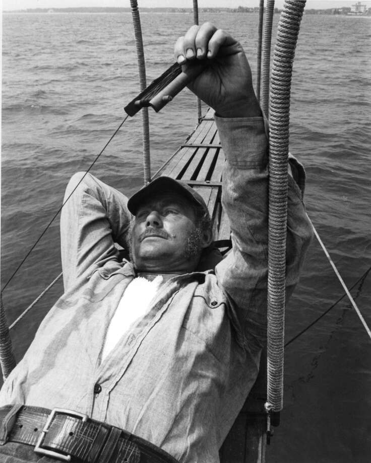 Robert Shaw lying down in boat in a scene from the film 'Jaws', 1975. Photo: Getty Images