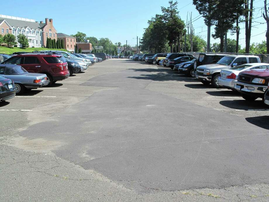 This section of the Elm Street train station parking lot will be torn up and repaved by the end of the month after an approval from the New Canaan Board of Selectmen Tuesday morning, Aug. 6. Photo: Tyler Woods