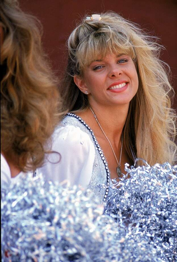 A Los Angeles Raiders Cheerleader in 1990. Photo: Markus Boesch, Getty Images