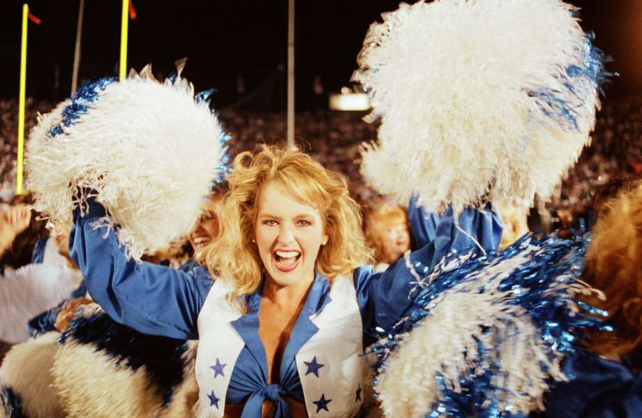 A Dallas Cowboys cheerleader celebrates the Dallas Cowboy's 1993 Pasadena, California, Superbowl XXVII win over the Buffalo Bills. Photo: George Rose, Getty Images