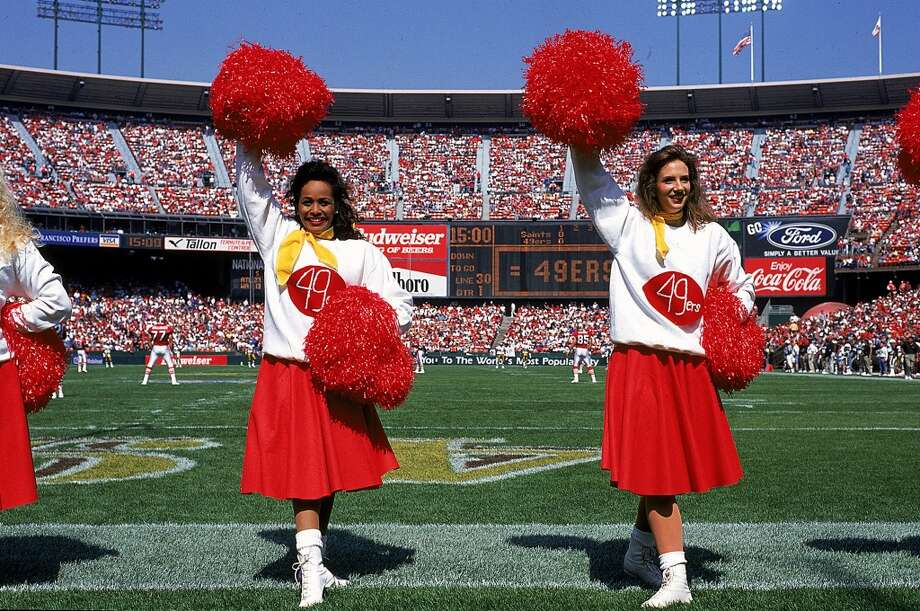 49ers Cheerleaders in old-style uniforms in 1994. Photo: Stephen Dunn, Getty Images