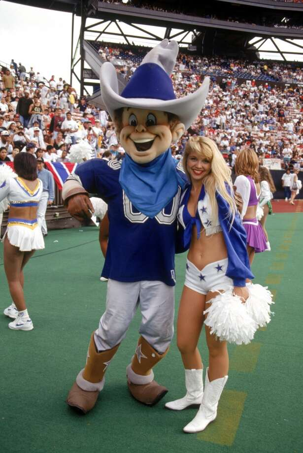 The Dallas Cowboys mascot and a Dallas cheerleader in 1995. Photo: George Rose, Getty Images