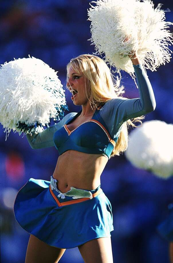 A cheerleaders for the Miami Dolphins in 1996. Photo: Andy Lyons, Getty Images