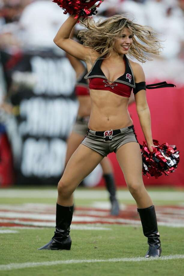 A cheerleader of the Tampa Bay Buccaneers in 2004 Photo: Robert Laberge, Getty Images