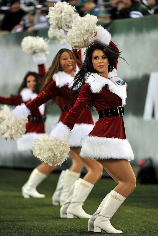 Cheerleaders of the New York Jets perform during their game against the Miami Dolphins at New Meadowlands Stadium on December 12, 2010. Photo: Jim Luzzi, Getty Images