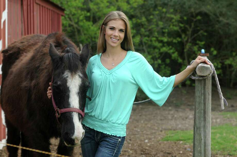 """Jackie Young, Miss Rodeo Houston 2013, spends time with her horse, """"Jewel,"""" at her home in The Highlands. Young grew up in Atascocita. She is a model and a student. Photo: Jerry Baker, Freelance"""