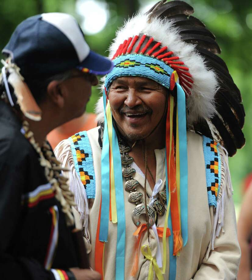 Dakota Nation Chief Gus High Eagle, right, laughs with Cheyenne River Sioux Wendell Deer with Horns during the Dakota Sioux Unity Ride ceremony to honor Albert Afraid of Hawk at Tarrywile Park in Danbury, Conn. on Tuesday, Aug. 6, 2013.  The riders, coming from Manitoba, Canada, stopped in Danbury to thank the community for returning Albert Afraid of Hawk's remains to his family and home in South Dakota.  Afraid of Hawk was an Oglala Sioux who died in Danbury in 1900 while working for Buffalo Bill's Wild West Show. Photo: Tyler Sizemore / The News-Times