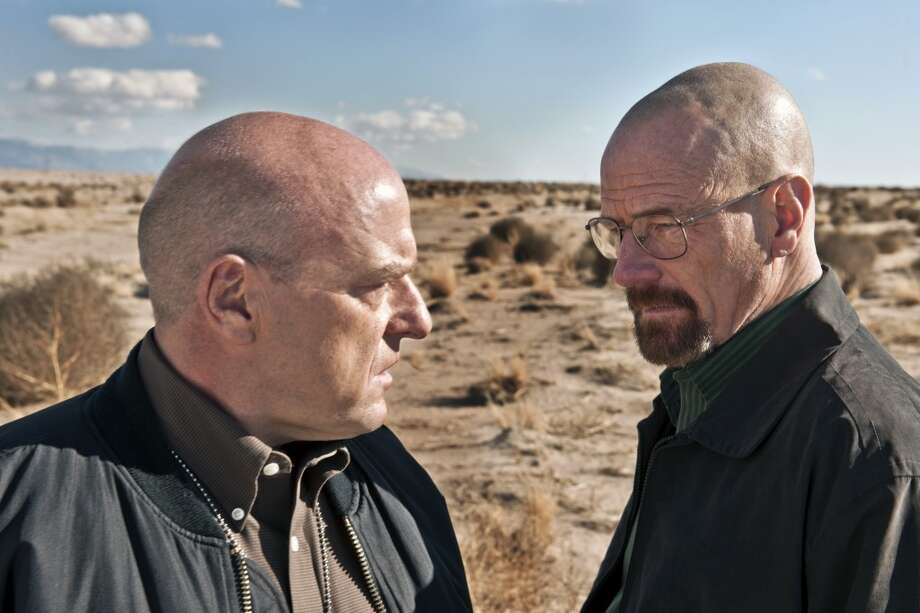 "This publicity image released by AMC shows Dean Norris as Hank Schrader, left, and Bryan Cranston as Walter White in ""Breaking Bad.""  The series is returning for its eight final episodes starting Sunday at 9 p.m. EDT. The long-awaited showdown places Hank in direct conflict with the villainous hero, Walter White. (AP Photo/AMC, Frank Ockenfels) Photo: Frank Ockenfels, Associated Press"
