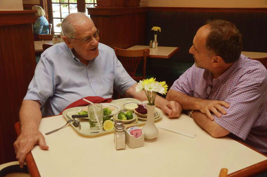 Cleburne Cafeteria George Mickelis, right, likes to chat with longtime customers such as Patton Condren. Photo: Jimmy Loyd / freelance