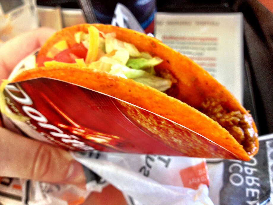 Taco Bell Doritos taco: Taco Bell had been getting a little too classy. (Photo by Karl Baron via Flickr) Photo: Karl Baron Via Flickr