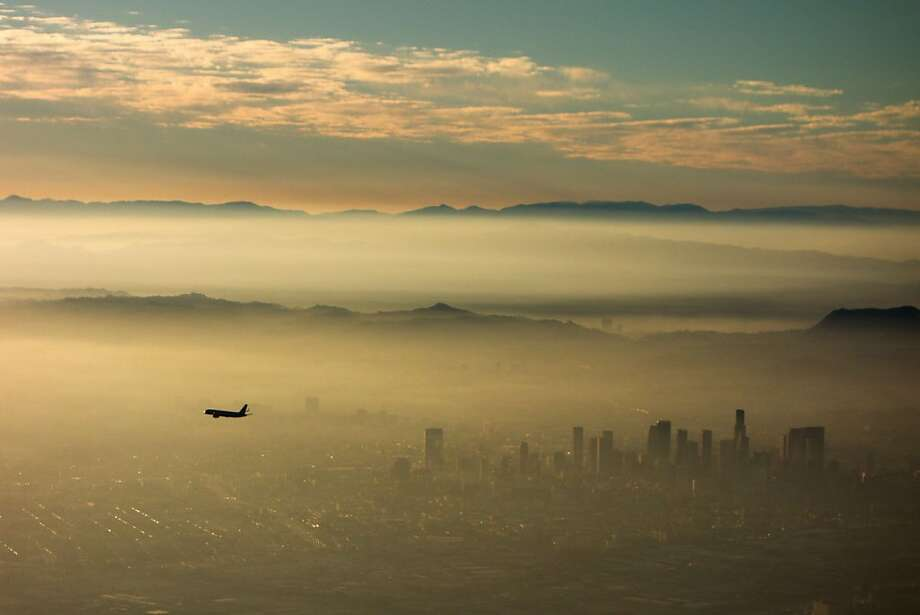 Leaving Los Angeles: A plane sails above the smog blanketing the City of Angels. Photo: Joe Klamar, AFP/Getty Images