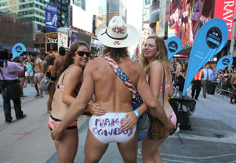 Every day is Underwear Day for him:The Naked Cowboy (tighty whitie-clad Robert John Burck) presses the flesh with two new friends celebrating national Underwear Day in Times Square. Photo: Donald Traill, Associated Press