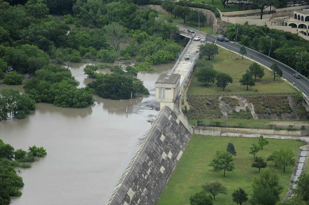 The Olmos Dam holds back flood waters after heavy rains in San Antonio on May 25.