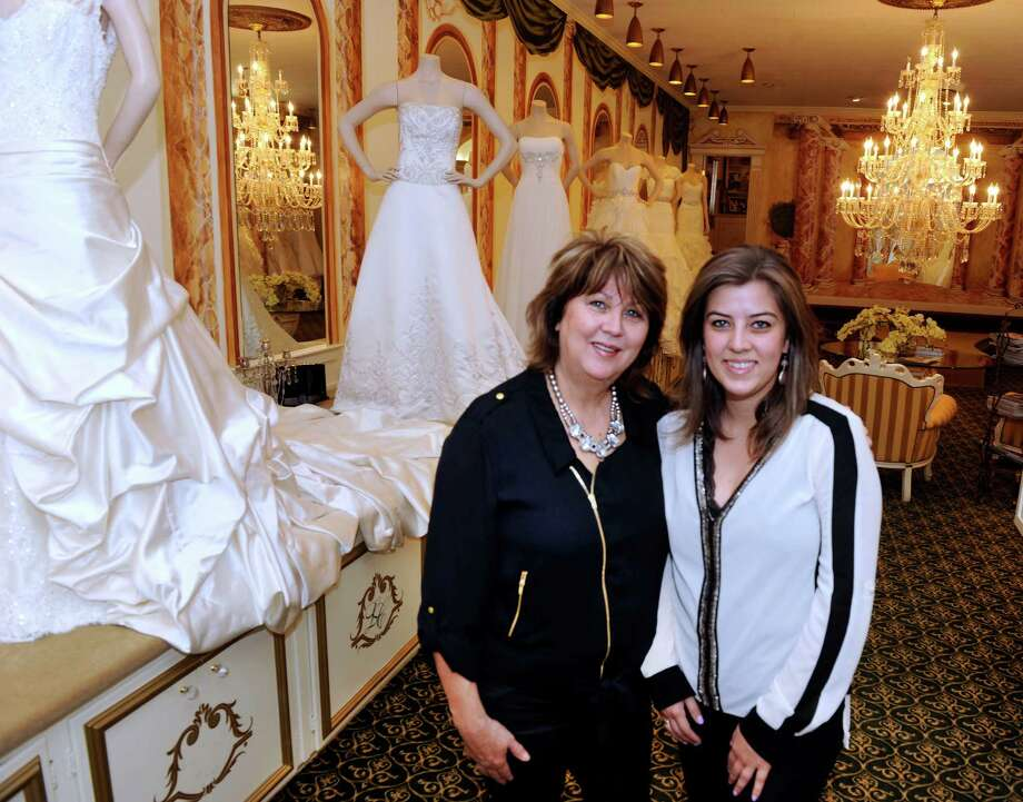 Ariete Robacher, 55, left, and her daughter, Morgana Laender, 25, both of Danbury, Conn., are photographed in their shop, Majesty Bridal, at 181 Main St. in Danbury, Tuesday, August 6, 2013. Photo: Carol Kaliff / The News-Times