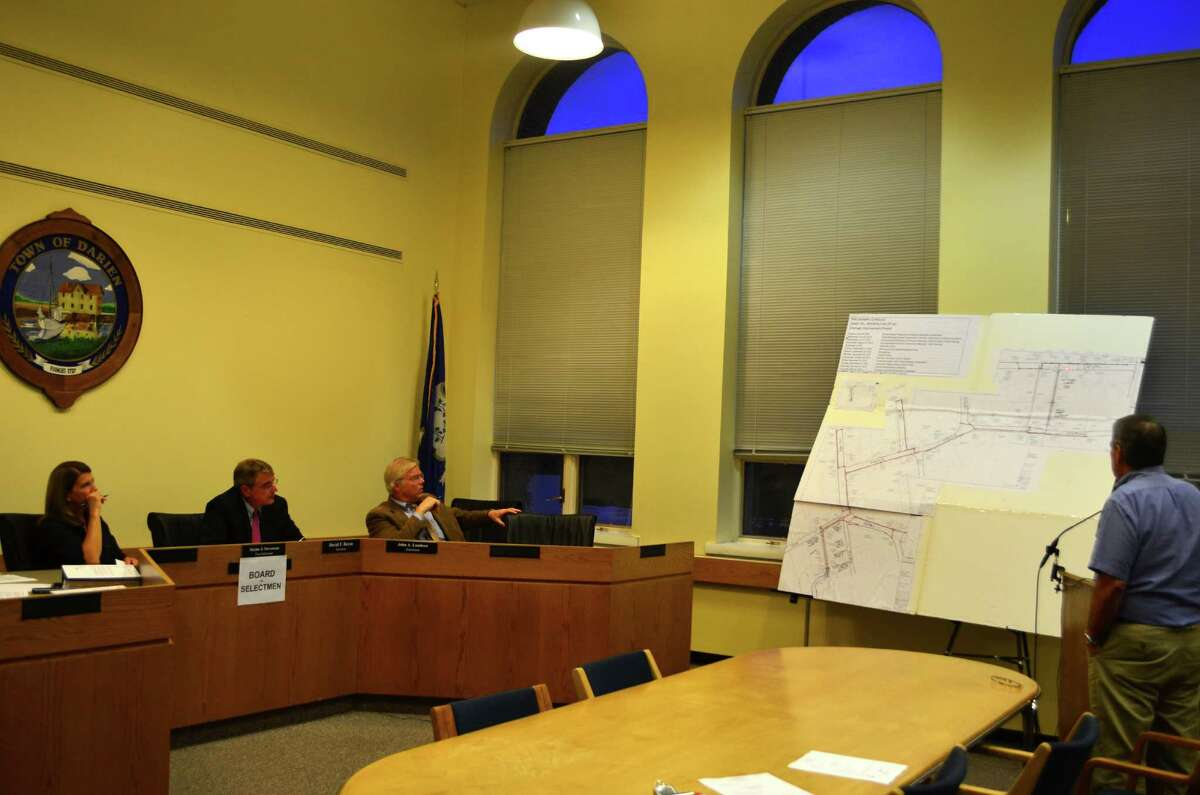 Director of Public Works Robert Steeger, far right, provides First Selectman Jayme Stevenson, from left, and Selectman David Bayne and John Lundeen with a presentation of the Intervale Drainage Project at the Monday, August 6 Board of Selectmen meeting.
