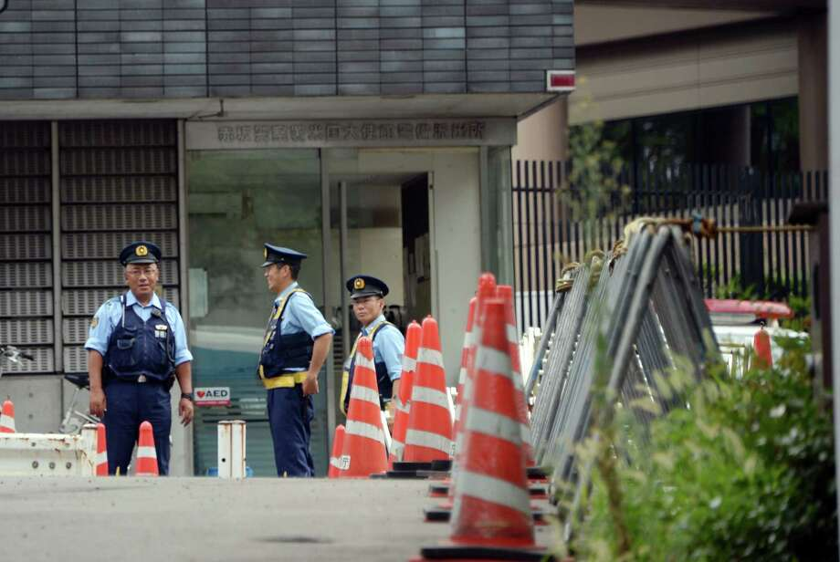 Police officers stand guard outside the U.S. embassy in Tokyo on Sunday. Interpol issued a global security alert after jailbreaks linked to al-Qaida freed hundreds of militants, as the United States and other Western powers planned to temporarily close certain embassies over terror threats. Photo: AFP / Getty Images