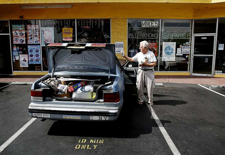 Jagoda, who has been in Palo Alto for four years, cleans out his car, that is also his office, after spending the night in it. Photo: Sarah Rice, Special To The Chronicle