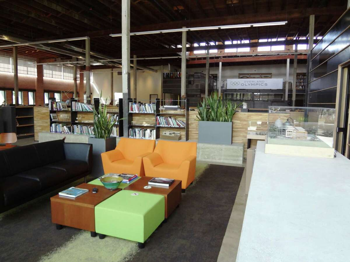 Colorful chairs furnish the reception area of Overland Partners headquarters.