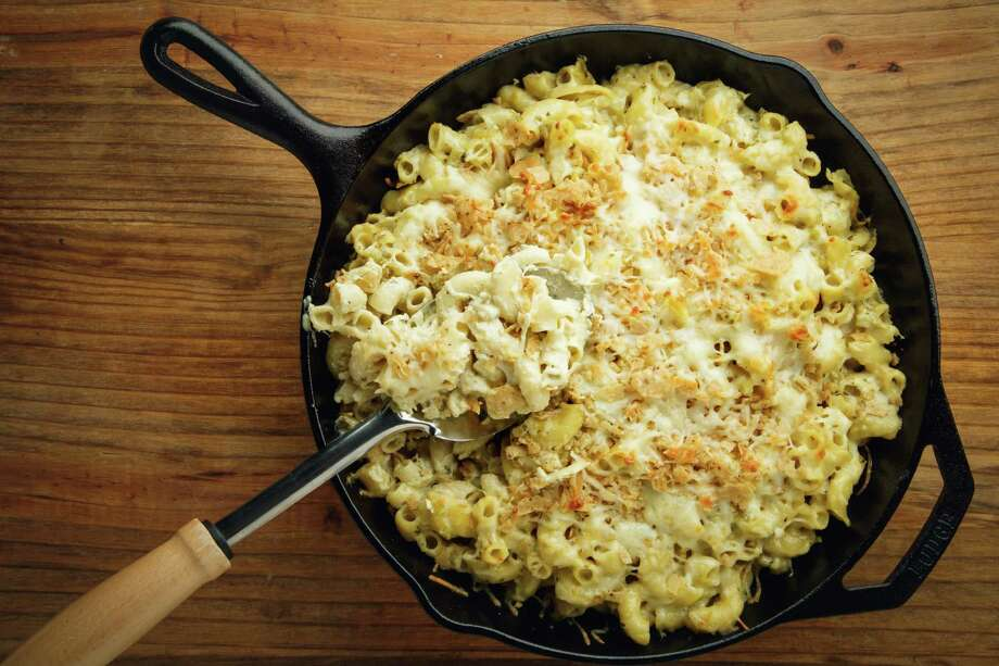 PHOTOS: The best mac and cheese in Houston Dig out your stretchy carb-eatin' pants, Houstonians. This Saturday afternoon comes the first Houston Mac and Cheese Fest, featuring dozens of restaurants offering up their own spin on the popular comfort dish alongside a selection of breweries serving up suds to wash it all down.Click through to see where to get your noodles and cheese fix in Houston...  Photo: Michael Paulsen, Staff / © 2013 Houston Chronicle