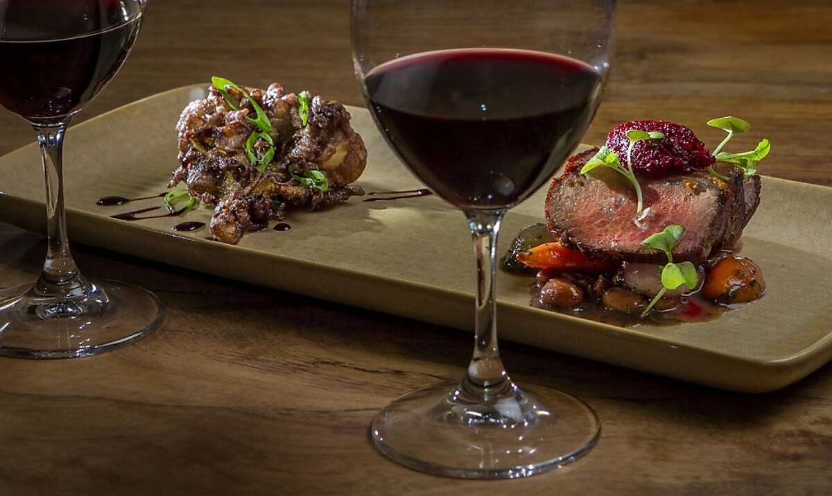 The Grand Reserve Merlot paired with Whole Vine Tempura Maitake Mushrooms, (left,) and Highland Estates Trace Ridge Cabernet paired with a smoked Loin of Lamb at Partake by K-J in Healdsburg, Calif., is seen on Thursday, August 1st, 2013.