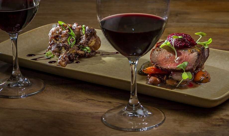 The Grand Reserve Merlot paired with Whole Vine Tempura Maitake Mushrooms, (left,) and Highland Estates Trace Ridge Cabernet paired with a smoked Loin of Lamb at Partake by K-J in Healdsburg, Calif., is seen on Thursday, August 1st, 2013. Photo: John Storey, Special To The Chronicle