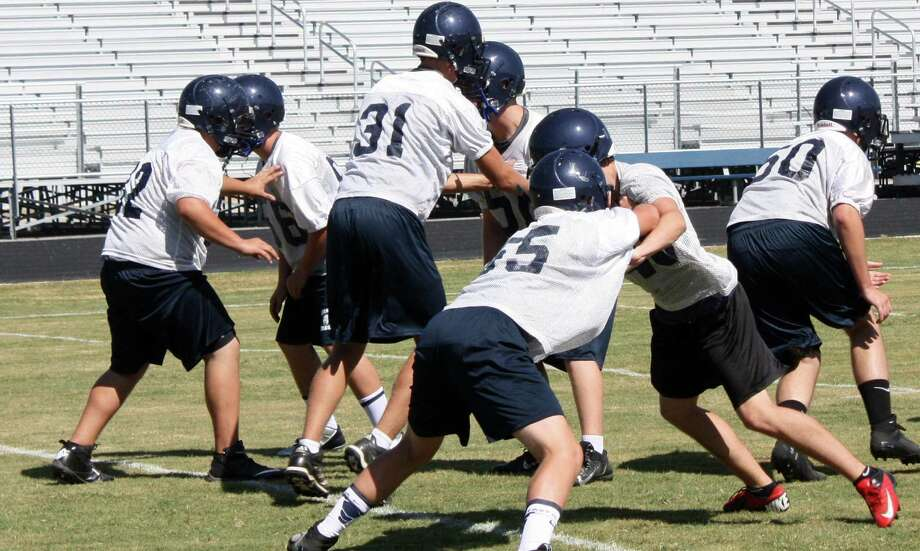 Boerne Champion freshmen linemen work on blocking drills during Monday's first session of two-a-day practices. Photo: Mike Reeder / For The Northwest Weekly
