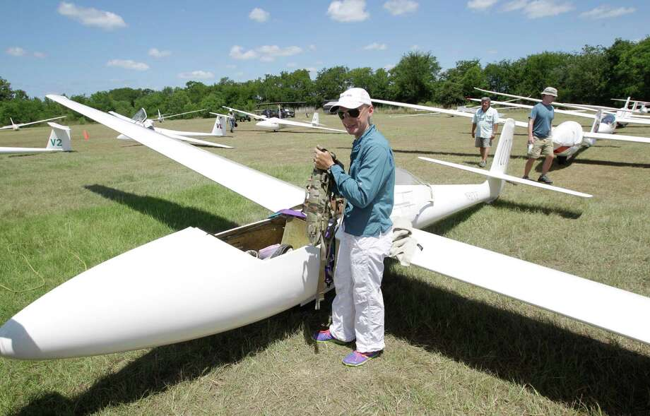 Sylvia Grandstaff prepares to put on her parachute as readies her glider during the Region 10 Championship at the Soaring Club of Houston Monday, Aug. 5, 2013, in Waller. Photo: Melissa Phillip, Houston Chronicle / © 2013  Houston Chronicle