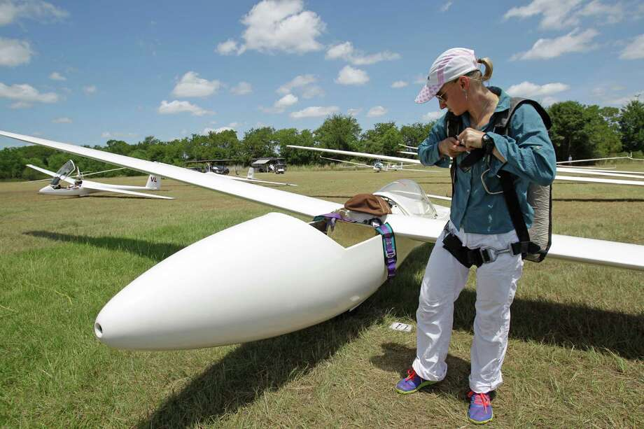 Sylvia Grandstaff puts on her parachute as readies her glider during the Region 10 Championship at the Soaring Club of Houston Monday, Aug. 5, 2013, in Waller. Photo: Melissa Phillip, Houston Chronicle / © 2013  Houston Chronicle