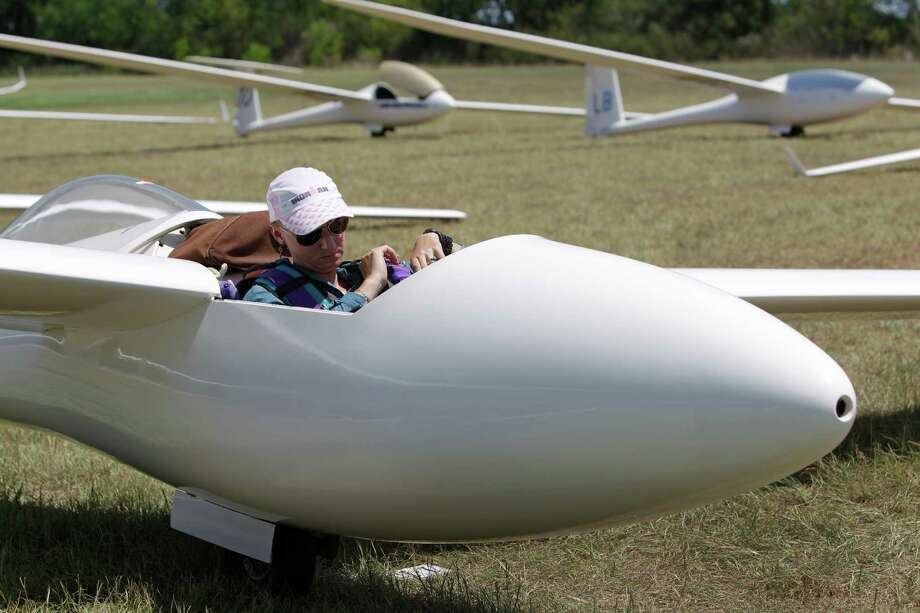 Sylvia Grandstaff  gets strapped into her glider during the Region 10 Championship at the Soaring Club of Houston Monday, Aug. 5, 2013, in Waller. Photo: Melissa Phillip, Houston Chronicle / © 2013  Houston Chronicle