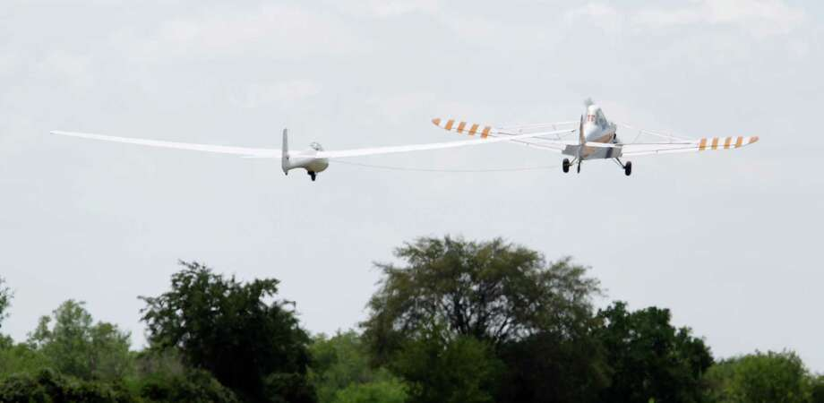 A glider flown by pilot Sylvia Grandstaff  is towed into the air by a Piper Pawnee during the Region 10 Championship at the Soaring Club of Houston Monday, Aug. 5, 2013, in Waller. Photo: Melissa Phillip, Houston Chronicle / © 2013  Houston Chronicle