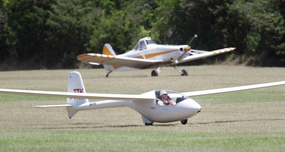 Glider pilot Rol Donie of Houston is towed into the air as another tow plane, a Piper Pawnee, lands in the background during the Region 10 Championship at the Soaring Club of Houston Monday, Aug. 5, 2013, in Waller. Photo: Melissa Phillip, Houston Chronicle / © 2013  Houston Chronicle