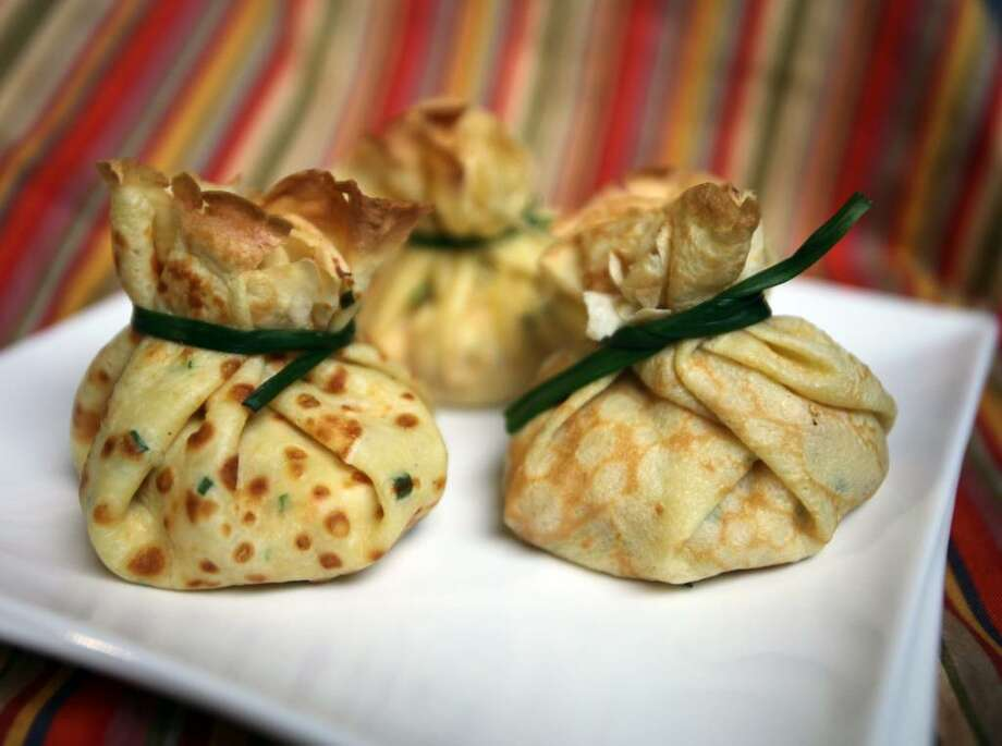 Crepes are fast and fancy to prepare like these Crepe Purses with Salmon filling. (Regina H. Boone/Detroit Free Press/MCT) Photo: REGINA H. BOONE, MCT / Detroit Free Press