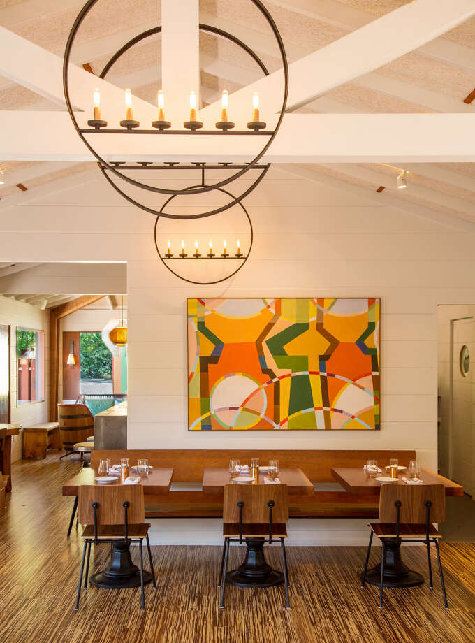 The contemporary geometric interior features picture windows facing Highway 1 and fixtures crafted by local artisans from recycled materials Photo: James Hall, Special To SFGate