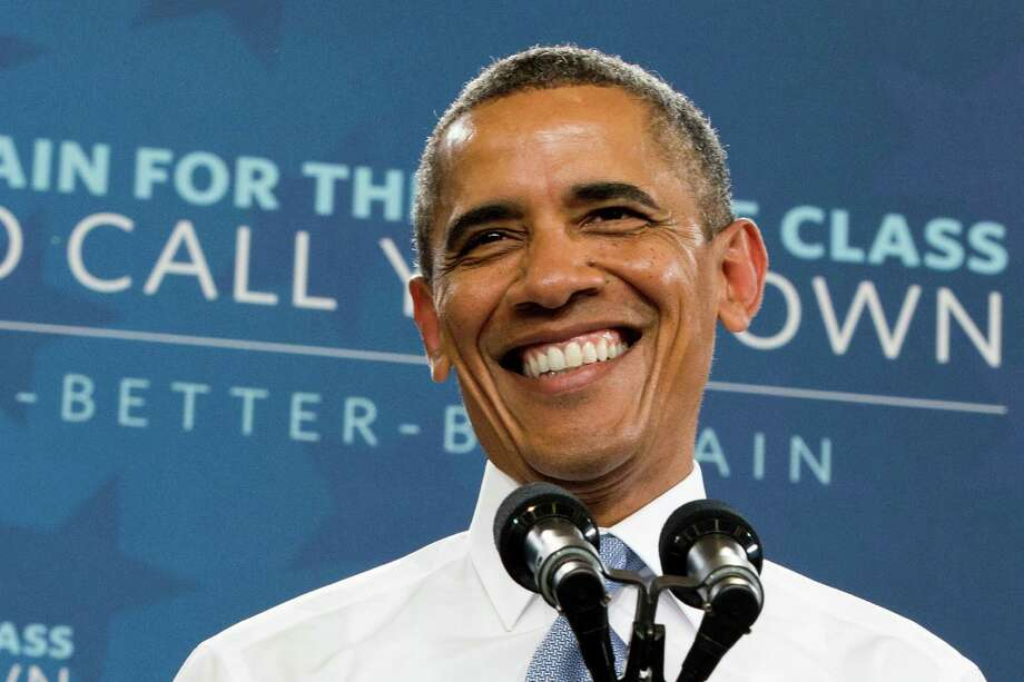 "President Barack Obama smiles as is warmly received before speaking about housing, Tuesday, Aug. 6, 2013,  at Desert Vista High School in Phoenix. The president said taxpayers can no longer be on the hook for bad decisions by mortgage lenders. Afterward he will head to Los Angeles to appear on ""The Tonight Show with Jay Leno."" Photo: Jacquelyn Martin"