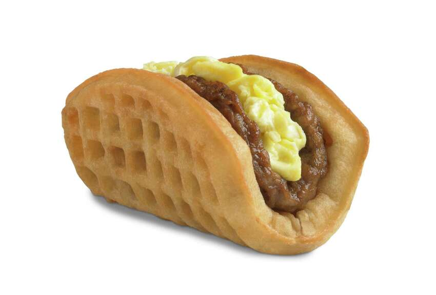This undated product image provided by Taco Bell, shows the company's new waffle taco. The fast-food chain says the waffle taco, which includes scrambled eggs, sausage and a side of syrup, was the top seller during breakfast hours at the five Southern California restaurants where they were tested earlier this year.