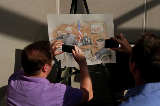 Members of the media photograph the rendering of Staff Sgt. Alonzo Lunsford Jr. testifying on the first day of the trial for Maj. Nidal Hasan at Fort Hood in Killeen on Tuesday, August 6, 2013. The rendering is by artist Brigitte Woosley, of New Braunfels. Photo: Express-News